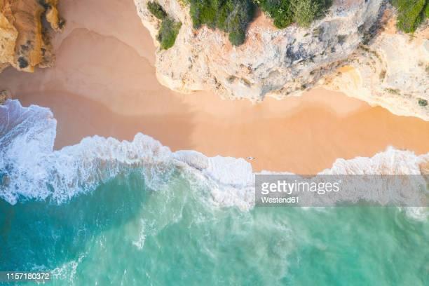 portugal, algarve, lagoa, praia da corredoura,  aerial view of beach, rocky coastline and sea - algarve imagens e fotografias de stock