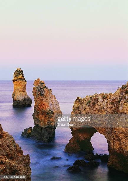Portugal, Algarve, rock formations at Ponta da Piedade, dusk
