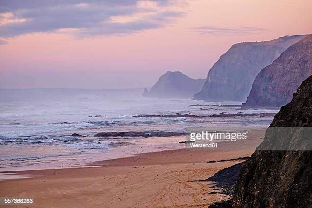 portugal, algarve, sagres, cordoama beach at twilight - sagres stock pictures, royalty-free photos & images