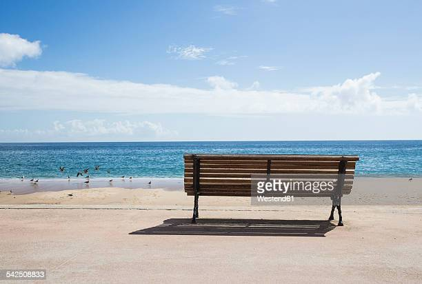Portugal, Algarve, Salema, Bench at seafront