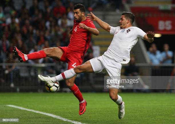 Portugal and AC Milan forward Andre Silva with Tunisia defender Yassine Meriah in action during the International Friendly match between Portugal and...