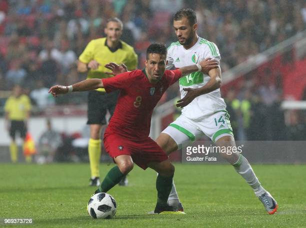 Portugal and AS Monaco midfielder Joao Moutinho with Algeria and JS Kabylie midfielder Salim Boukhenchouche in action during the International...