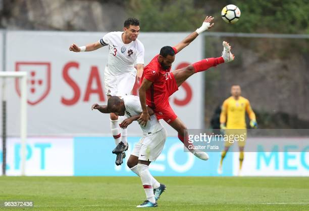 Portugal and Besiktas defender Pepe with Tunisia forward Saber Khalifa and Portugal and Leicester City FC defender Ricardo Pereira in action during...