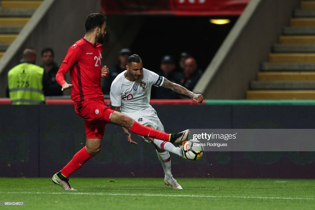 Portugal and Besiktas forward Ricardo Quaresma (B) vies with Tunisia midfielder Ghaylen Chaaleli (F) for the ball possession during the Portugal vs Tunisia International Friendly match on May 28, 2018 in Braga, Portugal.