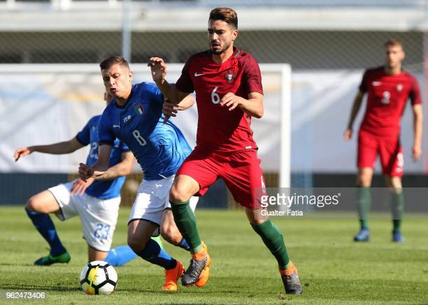 Portugal and Estoril Praia midfielder Pedro Rodrigues with Italy and Cagliari midfielder Nicolo Barella in action during the U21 International...