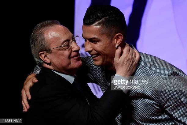 Portugal and Juventus forward Cristiano Ronaldo is congratulated by his former club Real Madrid's president Florentino Perez after receiving the...