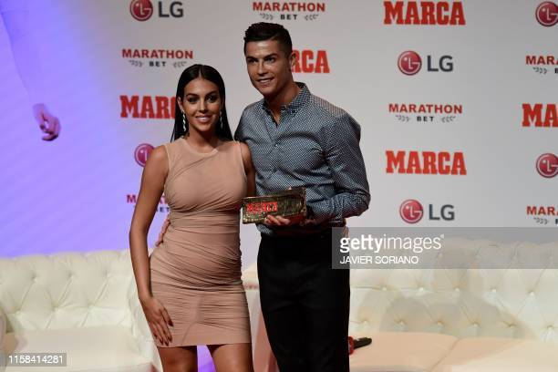 Portugal and Juventus forward Cristiano Ronaldo poses with his partner and Spanish model Georgina Rodriguez after receiving the MARCA Leyenda award...