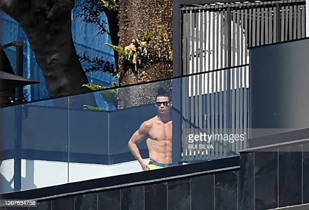 Portugal and Juventus' Portuguese forward Cristiano Ronaldo sunbathes at his home in Funchal on March 16 2020 Ronaldo has been in quarantine in...