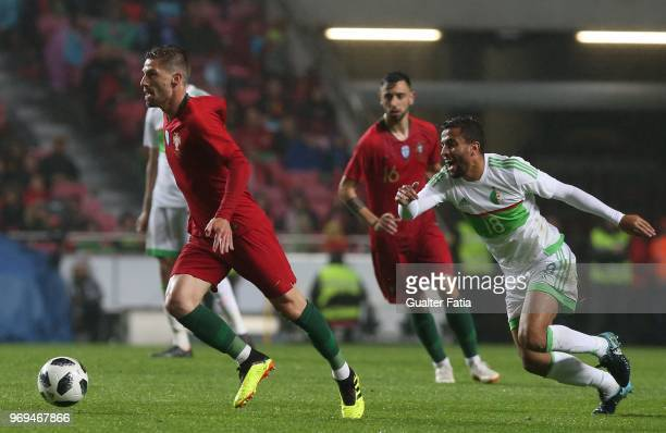 Portugal and Leicester City FC midfielder Adrien Silva with Algeria and USM Alger midfielder Mohamed Benkhemassa in action during the International...