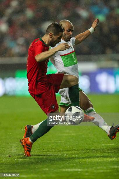Portugal and Manchester City midfielder Bernardo Silva vies with Algeria and Real Betis defender Aissa Mandi for the ball possession during Portugal...