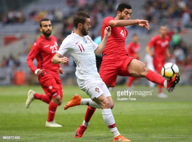 Portugal and Manchester City midfielder Bernardo Silva with Tunisia defender Yassine Meriah in action during the International Friendly match between...
