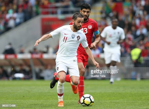 Portugal and Manchester City midfielder Bernardo Silva with Tunisia midfielder Farjani Sassi in action during the International Friendly match...