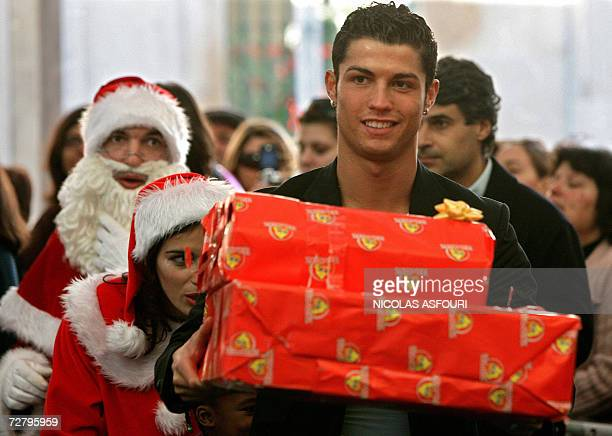 Portugal and Manchester United's football player Cristiano Ronaldo gives a Christmas gift to children at Obidos 70 km north of Lisbon 11 December...