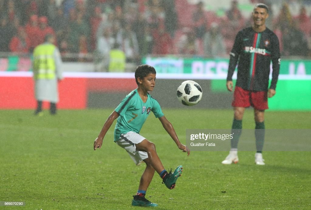 Portugal and Real Madrid forward Cristiano Ronaldo son Cristianinho plays with is father at the end of the International Friendly match between Portugal and Algeria at Estadio da Luz on June 7, 2018 in Lisbon, Portugal.
