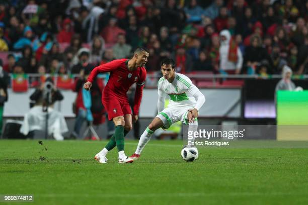 Portugal and Real Madrid forward Cristiano Ronaldo tries to pass trough Algeria and Real Betis defender Aissa Mandi during Portugal vs Algeria...