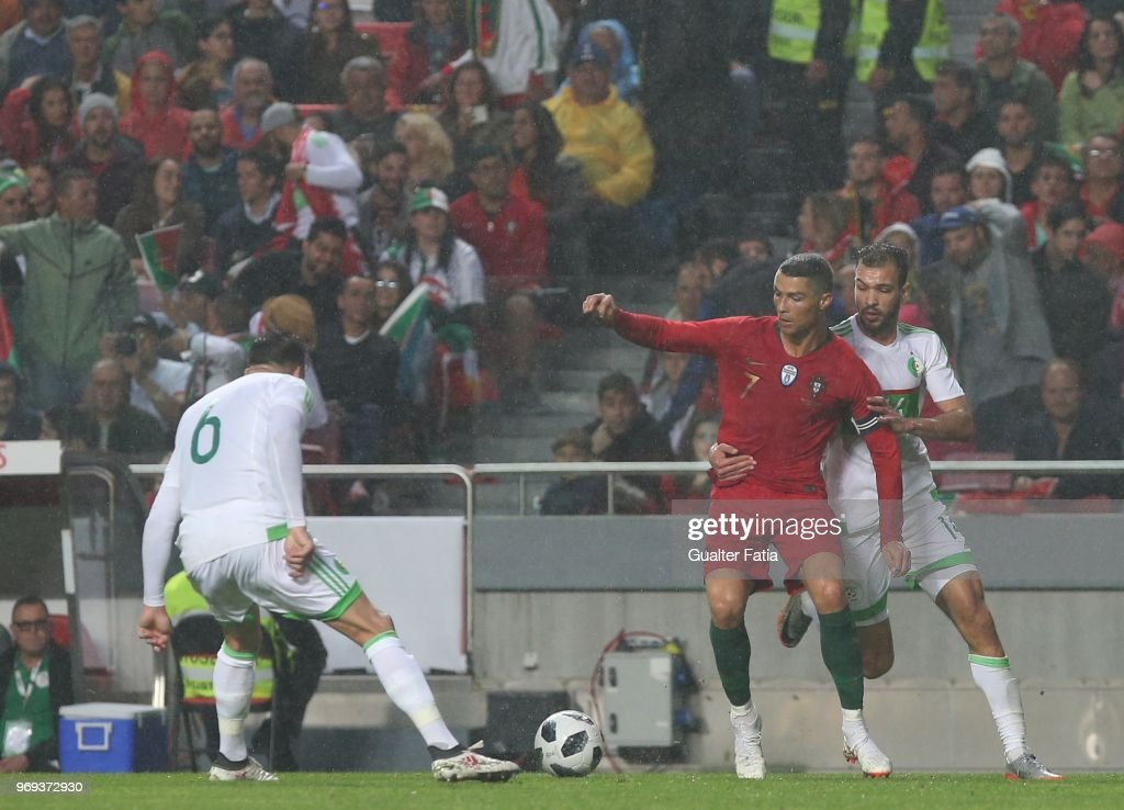 Portugal and Real Madrid forward Cristiano Ronaldo with Algeria and JS Kabylie midfielder Salim Boukhenchouche in action during the International Friendly match between Portugal and Algeria at Estadio da Luz on June 7, 2018 in Lisbon, Portugal.