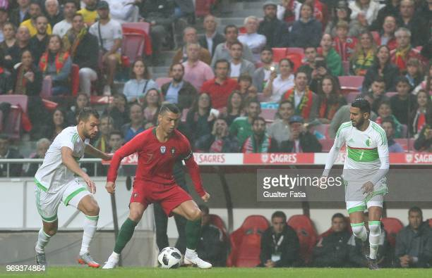 Portugal and Real Madrid forward Cristiano Ronaldo with Algeria and JS Kabylie midfielder Salim Boukhenchouche in action during the International...