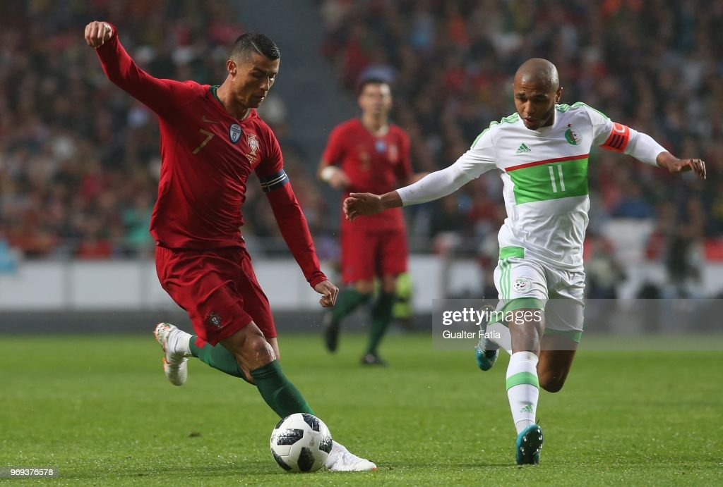 Portugal and Real Madrid forward Cristiano Ronaldo with Algeria and FC Porto forward Yacine Brahimi in action during the International Friendly match between Portugal and Algeria at Estadio da Luz on June 7, 2018 in Lisbon, Portugal.