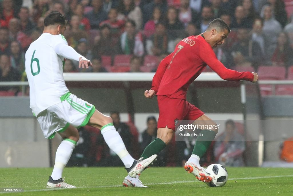 Portugal and Real Madrid forward Cristiano Ronaldo with Algeria and Sivasspor defender Carl Medjani in action during the International Friendly match between Portugal and Algeria at Estadio da Luz on June 7, 2018 in Lisbon, Portugal.