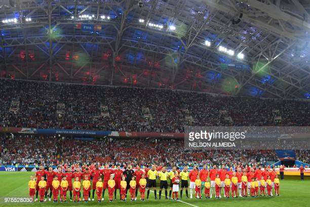 Portugal and Spain national football teams line up to listen to their national anthems before the Russia 2018 World Cup Group B football match...