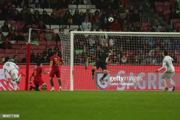 Portugal and Sporting CP goalkeeper Rui Patricio saves a goal during Portugal vs Algeria International Friendly match at Estadio da Luz on June 7...