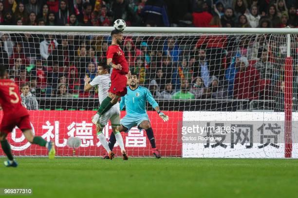 Portugal and Sporting CP midfielder Bruno Fernandes heads during Portugal vs Algeria International Friendly match at Estadio da Luz on June 7 2018 in...