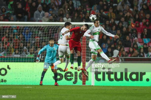 Portugal and Sporting CP midfielder Bruno Fernandes vies with Algeria and Le Havre midfielder Zineddine Ferhat and Algeria and Real Betis defender...