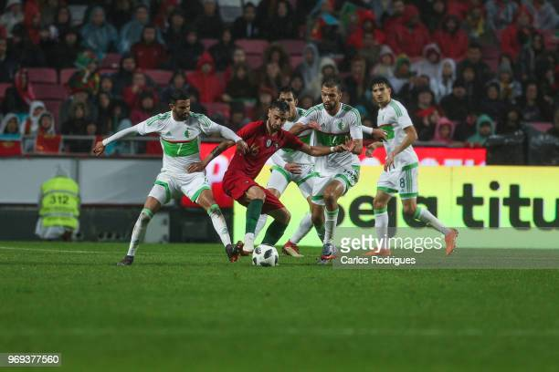 Portugal and Sporting CP midfielder Bruno Fernandes vies with Algeria defenders for the ball possession during Portugal vs Algeria International...