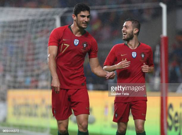 Portugal and Valencia FC forward Goncalo Guedes celebrates with teammate Portugal and Manchester City midfielder Bernardo Silva after scoring a goal...