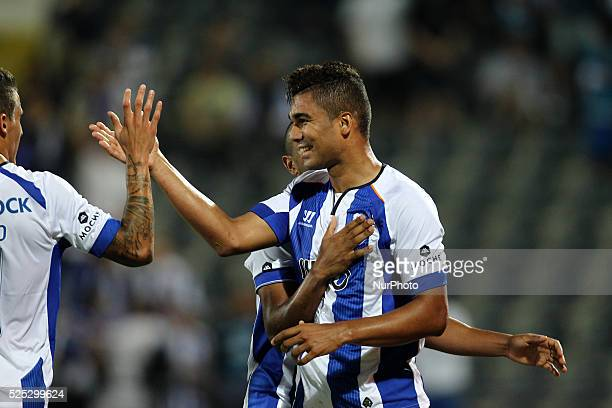 Porto's Brazilian midfielder Casemiro celebrates after scoring during the Premier League 2014/15 match between FC Arouca and FC Porto at Municipal de...