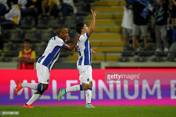 Porto's Colombian midfielder Juan Quintero celebrates after scoring with Porto's Algerian midfielder Yacine Brahimi during the Premier League 2014/15...