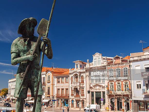 Portugal, Aveiro, Fisherman statue in the canals