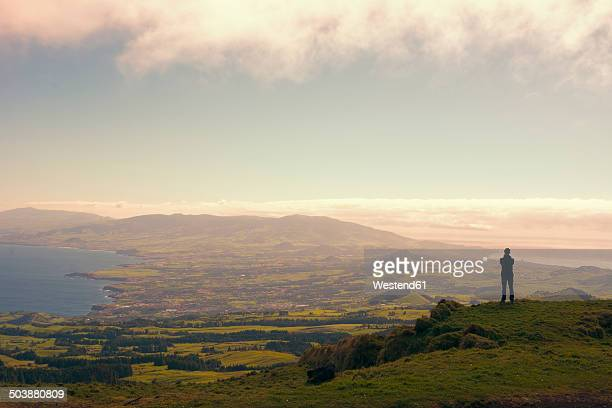 portugal, azores,sao miguel, tourist capturing view - las azores fotografías e imágenes de stock