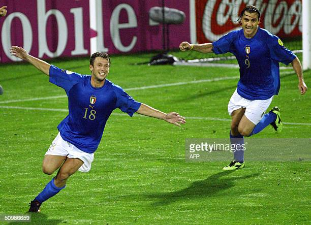CAPTION CORRECTION ID player at L Italian Antonio Cassano celebrates next to Italian forward Christian Vieri after scoring the second goal for his...