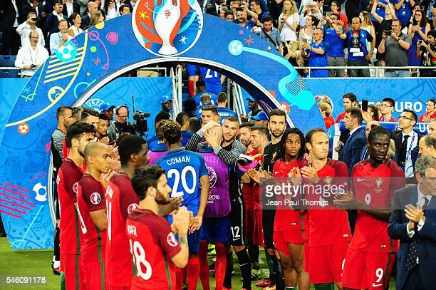 Portugal clap France off the field Christophe JALLET and Anthony LOPES during the European Championship Final between Portugal and France at Stade de...