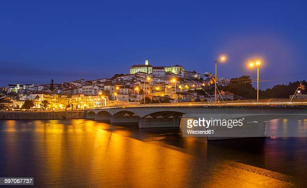 Portugal, Coimbra, historical old town, Mondego river and bridge Santa Clara in the evening