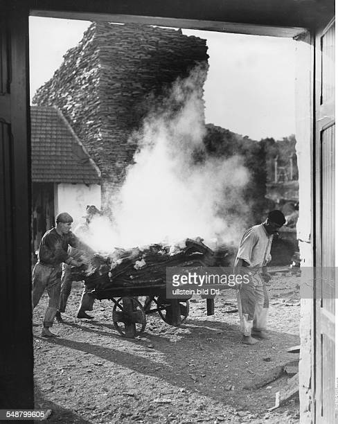 Portugal cork industry men pushing a cart loaded with hot and dampish cork date unknown probably 1936 photo by Eric Borchert picture belongs to a...