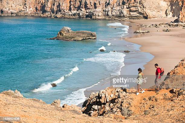 portugal, couple hiking on mountain - sagres stock pictures, royalty-free photos & images