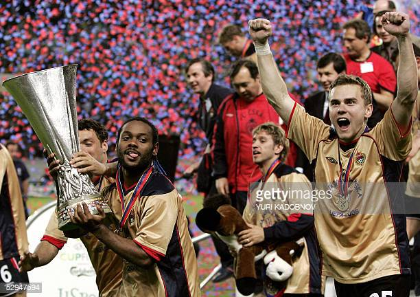 Moscow's Brazilian forward Vagner Love celebrates with the trophy at the end of the UEFA cup final football match Sporting Lisbon vs CSKA Moscow, 18...