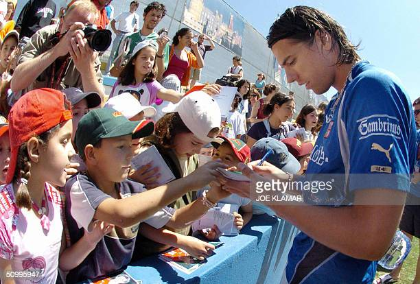 Czech player Milan Baros signs autographs for school children at the end of the Czech national team's practice in Sintra 25 June 2004 The Czech...