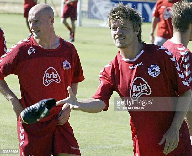 Danish defender Thomas Helveg throws his shoe away next to midfielder Thomas Gravesen during a training session at their training base outside...