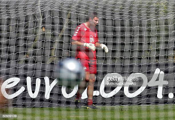 Danish goalkeeper Stephan Andersen is seen through nets during a training session at the Le Meridien Golf and Country Club in Portimao on the Algarve...