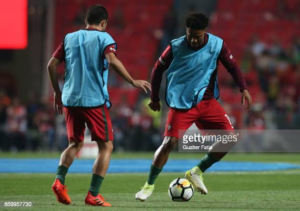 Portugal defender Eliseu with Portugal midfielder Joao Moutinho in action during warm up before the start of the FIFA 2018 World Cup Qualifier match...