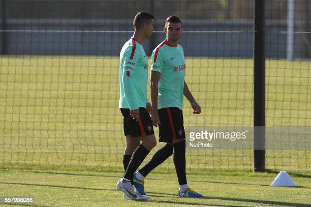 Portugal defender Pepe talks with Portugal forward Cristiano Ronaldo during National Team Training session before the match between Portugal and...
