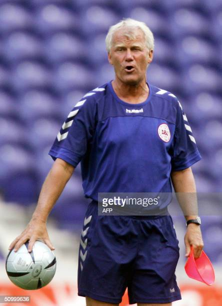 Denmark's coach Morten Olsen leaves the field at the end of a training session in Porto's Dragao stadium 26 June 2004 Denmark will play their Euro...