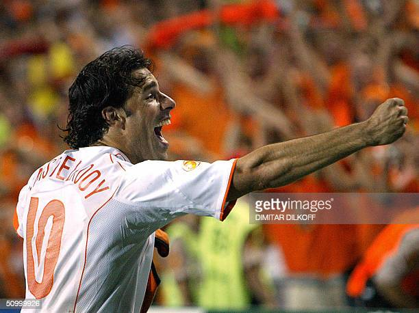 Dutch forward Ruud Van Nistelrooy celebrates,26 June 2004 at the Algarve stadium in Faro, at the end of the Euro 2004 quarter final match between...