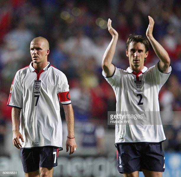 England captain David Beckham and defender Gary Neville look dejected after losing to France 21 13 June 2004 during their opening match at the...