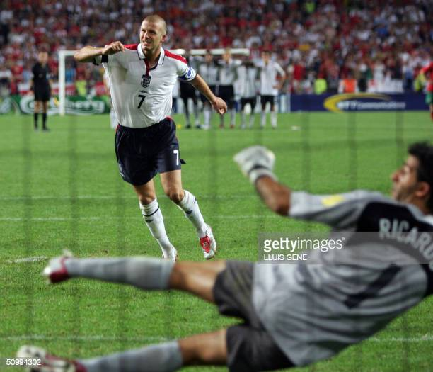 England captain David Beckham in front of Portugal's goalkeeper Ricardo misses his penalty kick 24 June 2004 during their European Nations...