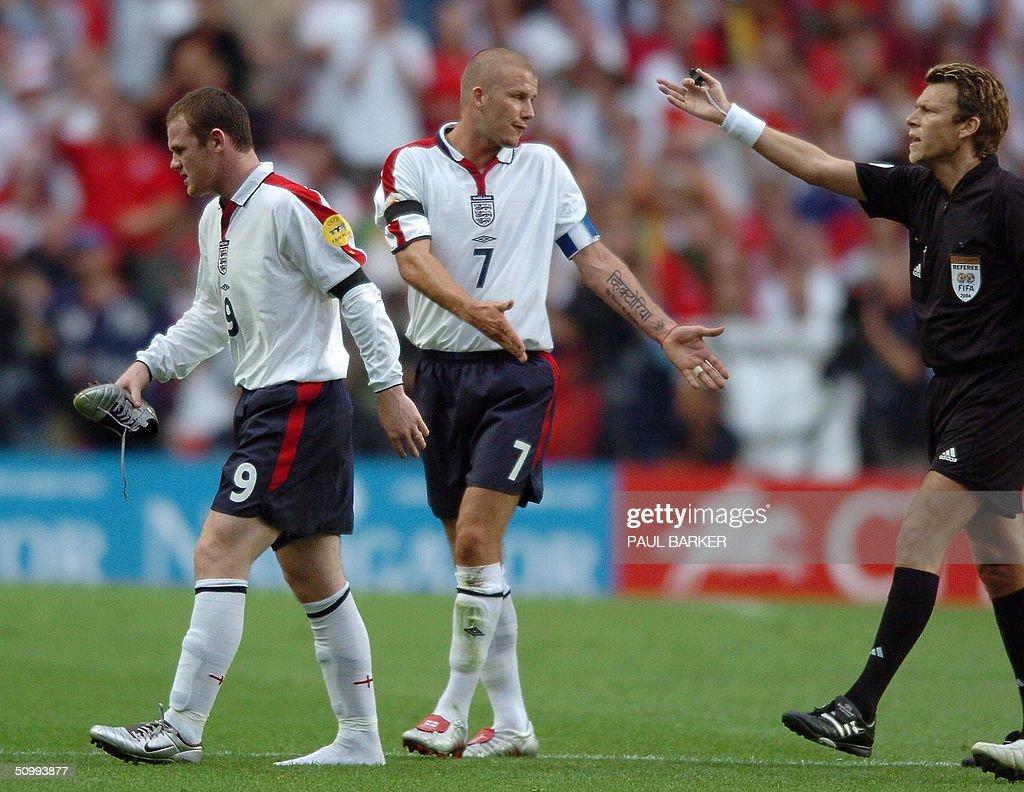 England forward Wayne Rooney (R) leaves : News Photo