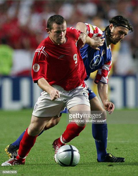 England forward Wayne Rooney tussles with Croatia's midfielder Niko Kovac 21 June 2004 during their European Nations football championships match at...